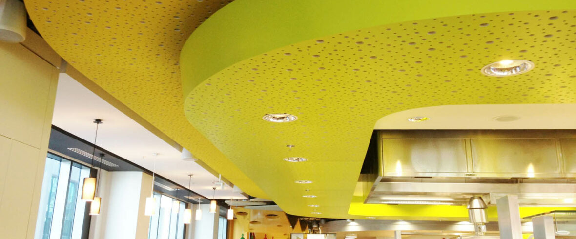 Yellow Ceiling with plasterboard panels with acoustic properties